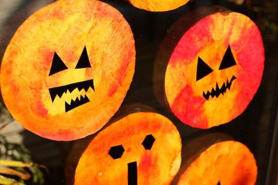Close up of pumpkin sun catchers on window