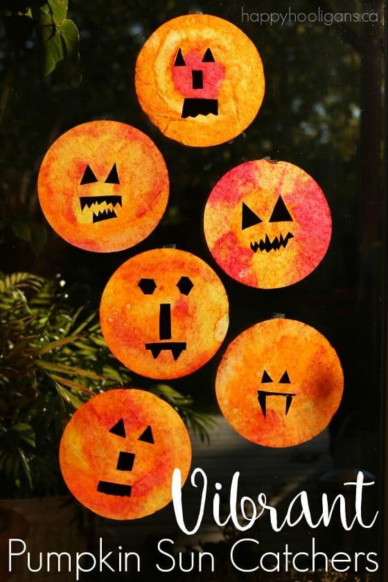 Vibrant Pumpkin Sun Catchers for Kids to Make - Happy Hooligans