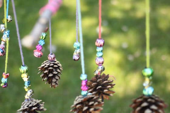 mobile-craft-with-sticks-pinecones-yarn-and-beads
