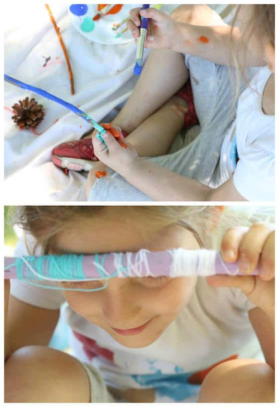 preschooler-painting-sticks-and-wrapping-with-yarn