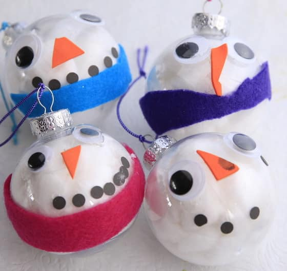 4 snowman ornaments made with clear glass balls