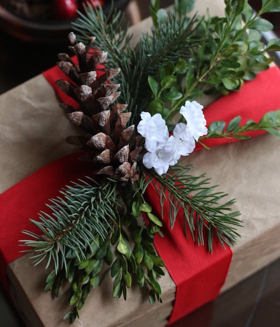 gift wrapped in brown paper, ribbon and natural items