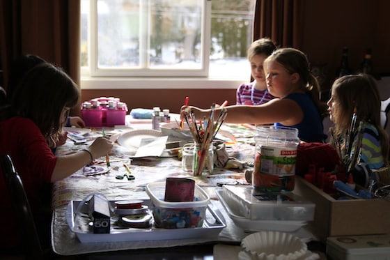 Daycare kids making crafts at dining room table