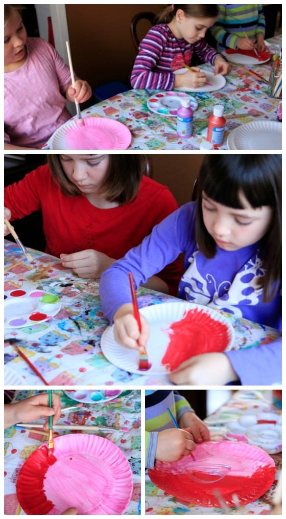 Kids painting paper plates for Valentines Craft
