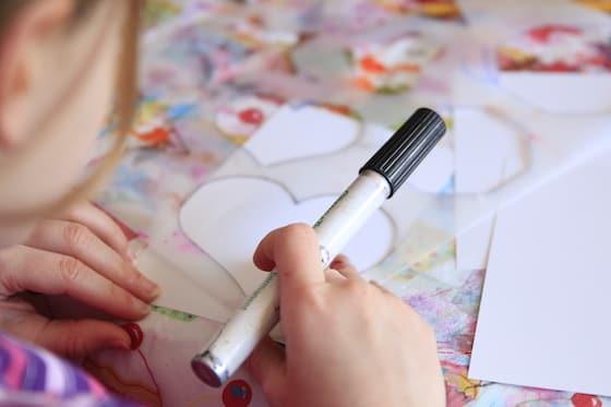 Preschooler tracing a heart