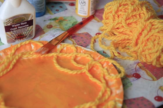 gluing yarn mane to paper plate