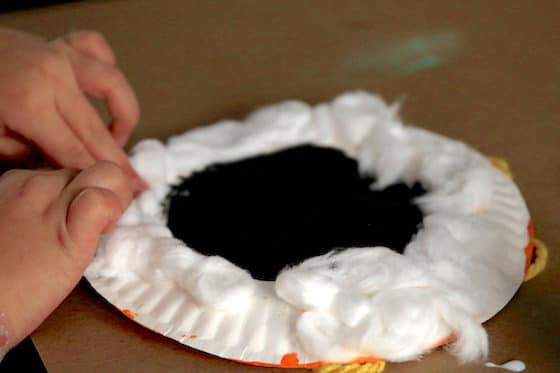 Making a lamb with paper plate and cotton balls