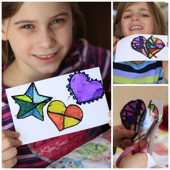Kids showing finished Sharpie and Photo Paper Hearts