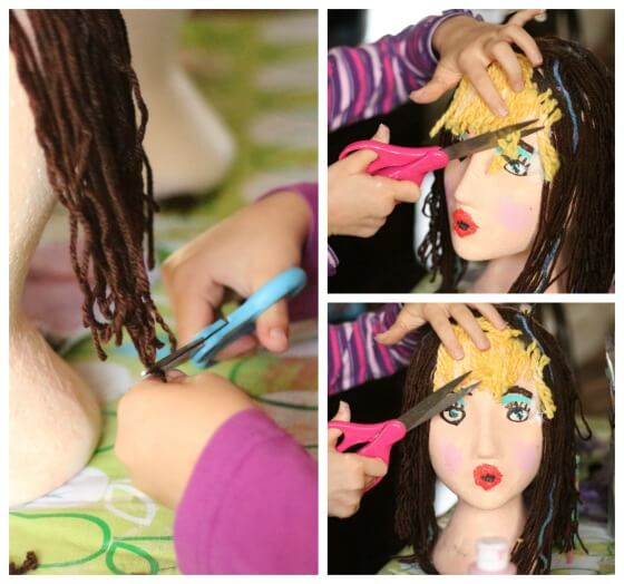 kids Cutting yarn hair on styrofoam head craft