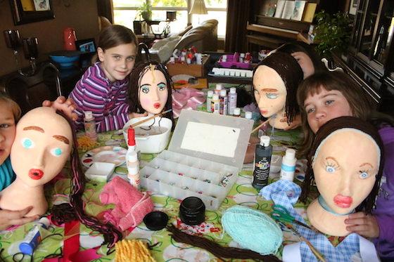 kids posing with styrofoam head self-portraits