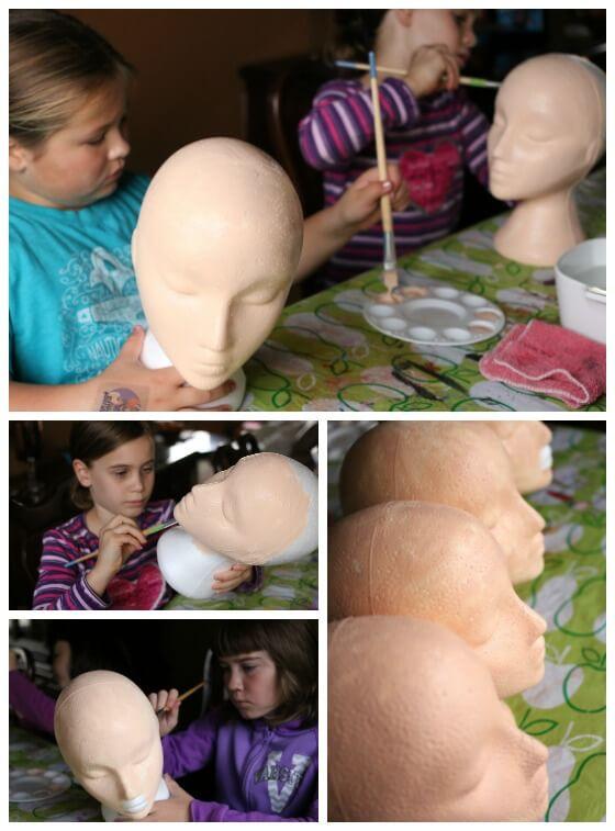 kids painting styrofoam heads with acrylic craft paint