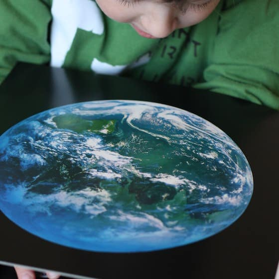 Child looking at satellite picture of Earth