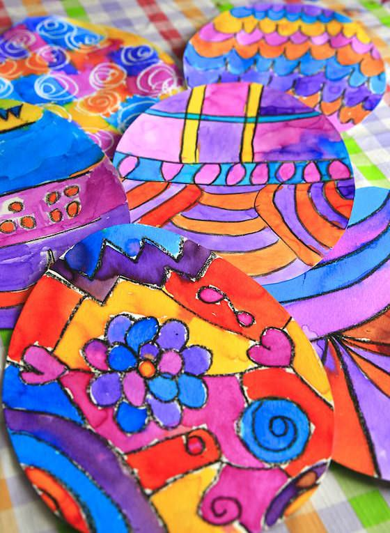 Colourful Easter art for kids with crayon and liquid watercolours