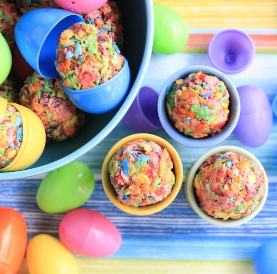 Overhead view of bowl and egg cups filled with colourful easter treats