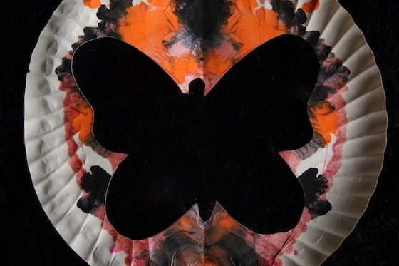 Butterfly silhouette with orange and black background