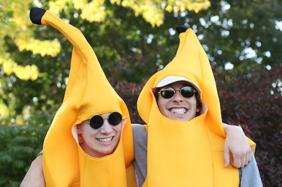 brothers in banana suit costumes getting along