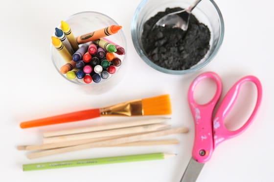 henna hand art supplies - crayons, black paint, candy apple sticks, scissors