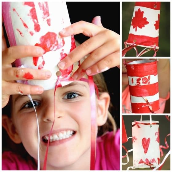 Child holding handprint windsock