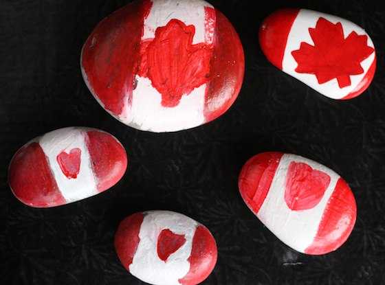 Beach Rocks painted to look like Canadian Flags