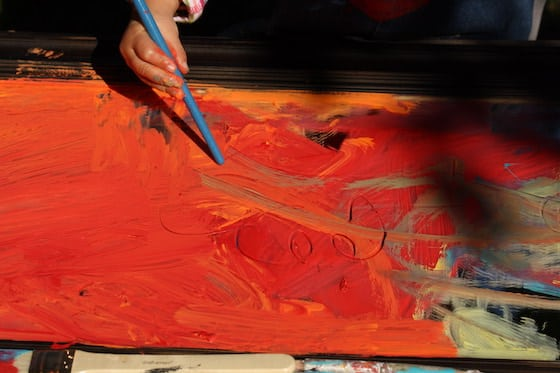 scratching paint with end of paintbrush