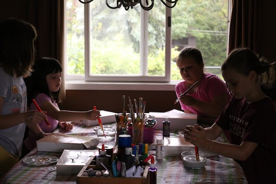 Kids crafting at dining table