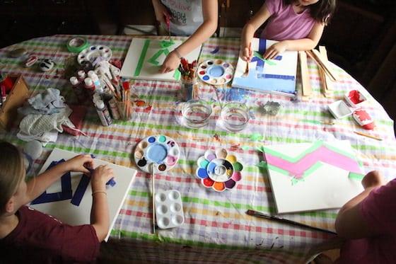 Kids making tape resist art