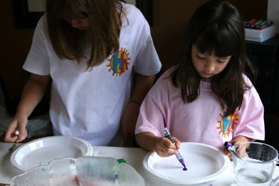 kids doing dry erase and water experiment