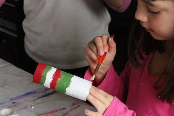 child painting paper towel roll - red green and white strips