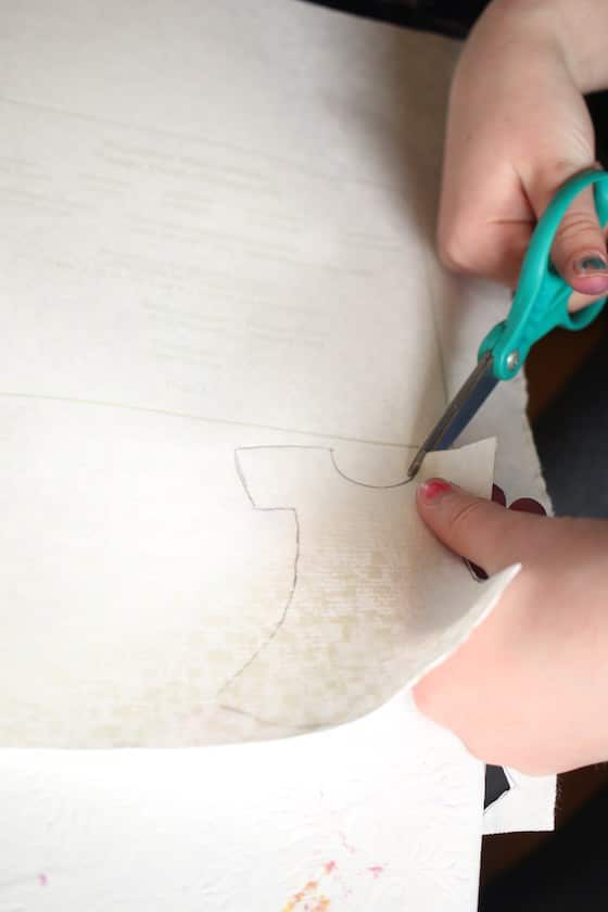 kids cutting dresses out of wallpaper samples
