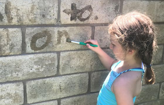 Water Painting- sight words on a wall