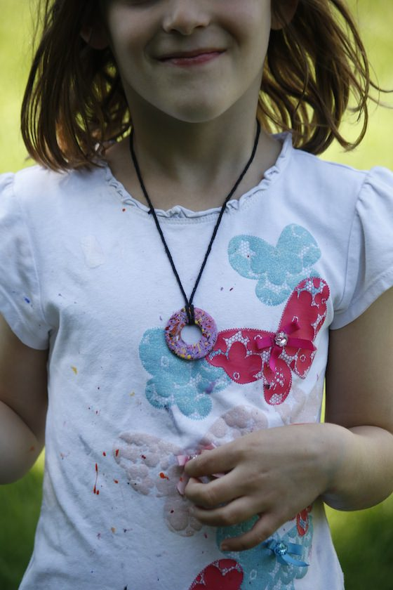 child wearing painted washer necklace