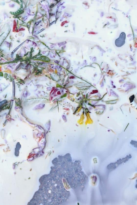 flowers and leaves in bin of homemade ooblek