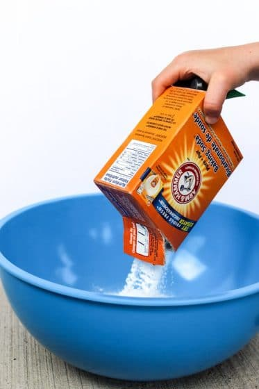 pouring baking soda into bowl