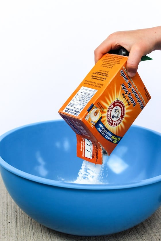 pouring baking soda into bowl