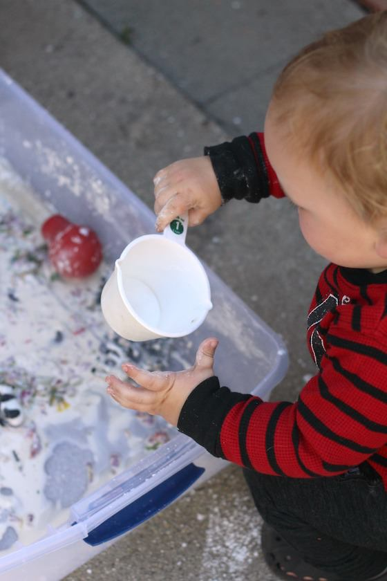 toddler playing with goop