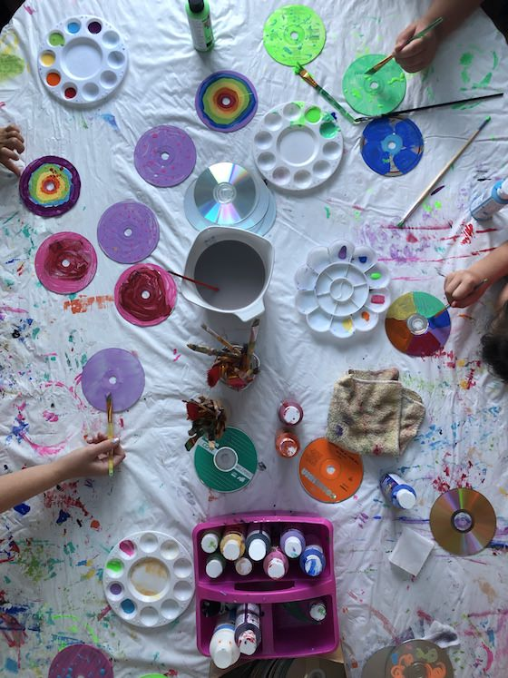 Kids painting CDs with acrylic craft paint