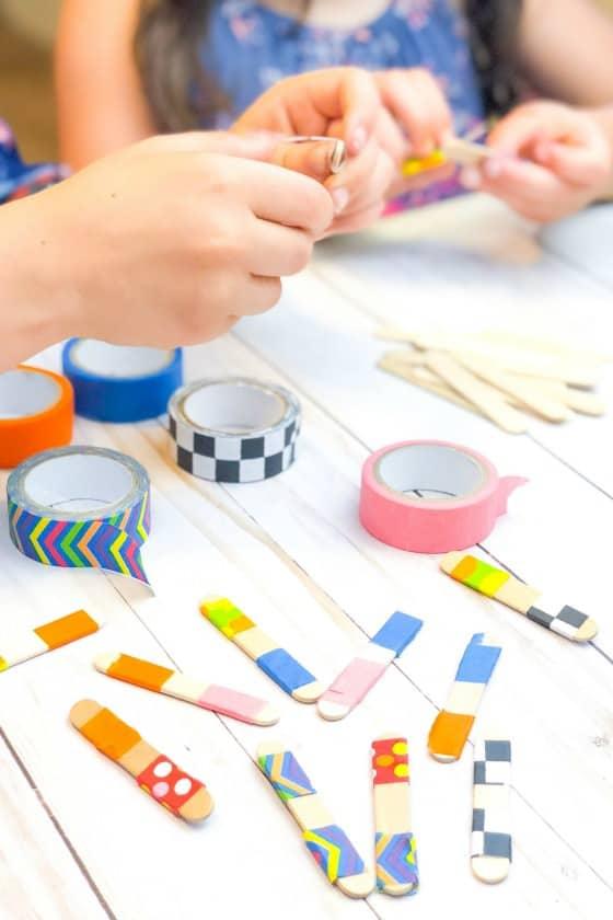 kids making homemade dominoes from craft sticks