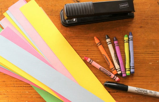 crayons, stapler, marker, paper strips