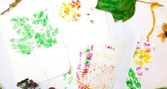 prints made by stamping flowers and leaves
