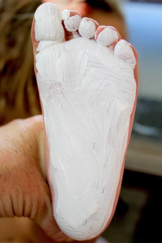 Child's foot painted white