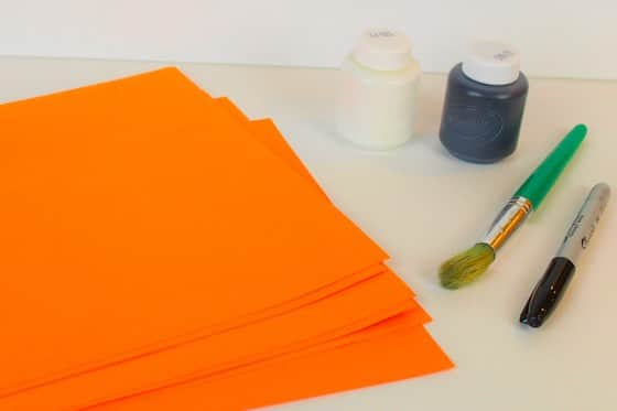 Orange contstruction paper with white and black paint