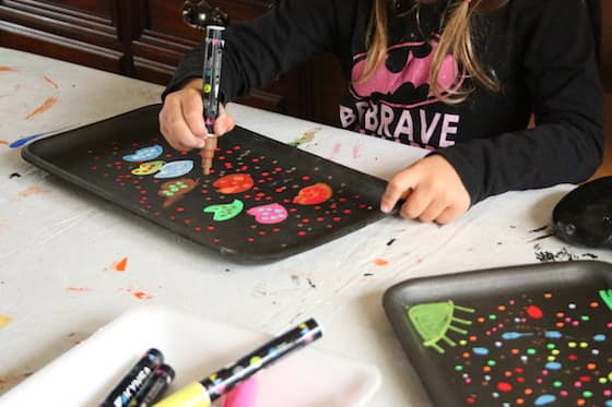 kids using chalk markers