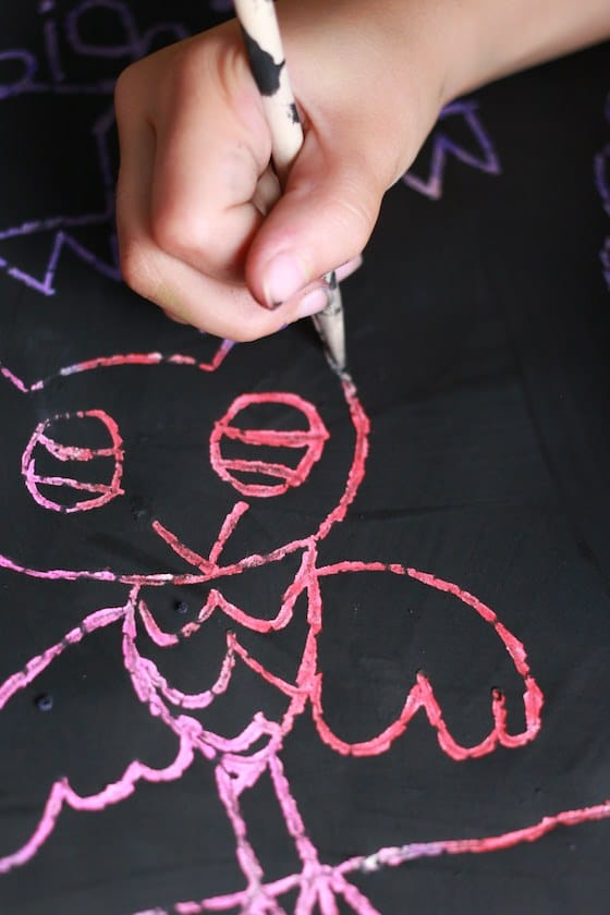 child drawing owl with scratch art