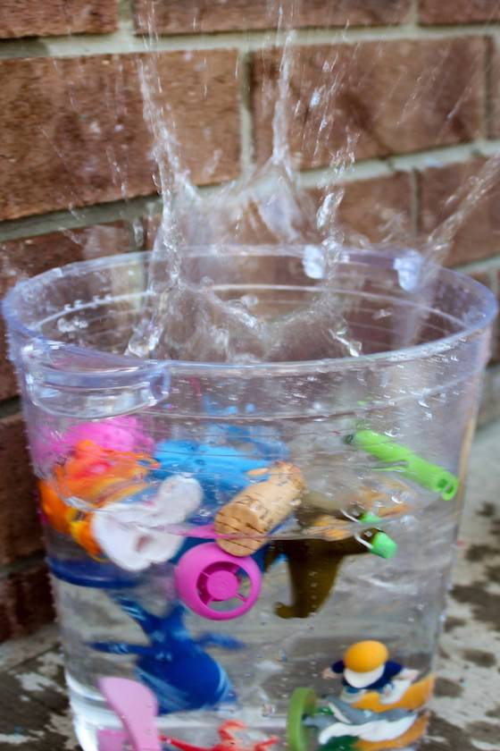splash from kids dropping toys in water