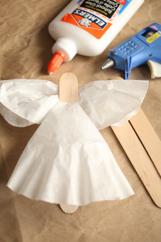 Gluing coffee filters to popsicle stick