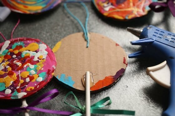gluing stick on lollipop craft