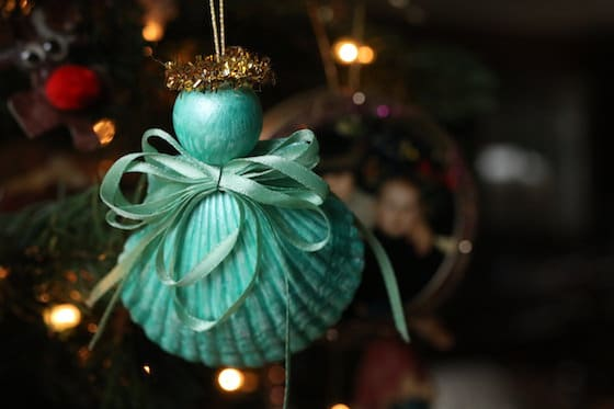 Painted seashell angel ornament on Christmas tree