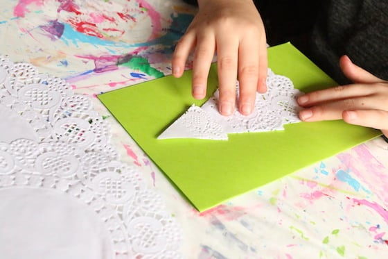kid making doily christmas card