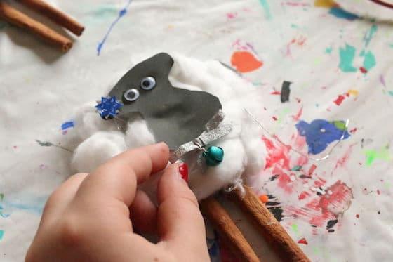 kid making sheep ornament