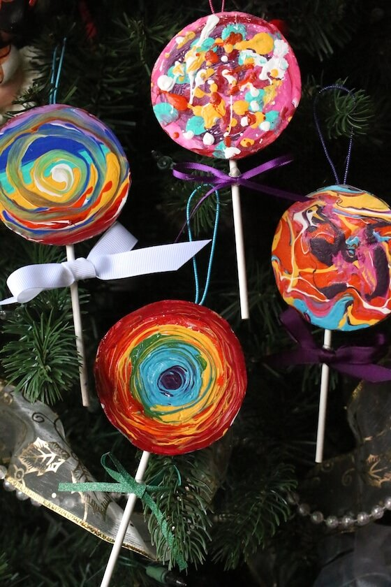 3 painted cardboard lolly pop ornaments on Christmas tree